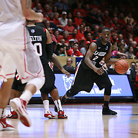18 January 2012: San Diego State Aztec #2 Xavier Thames brings the ball up the court late in the second half.  San Diego State Aztecs defeated the New Mexico Lobos Lobos 75 - 70 at The Pit in Albuquerque, NM.