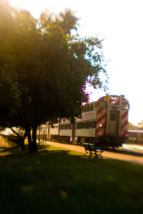 A Lensbaby captures a Chicago-bound Metra commuter train passing the LaVergne station in suburban Berwyn, IL.