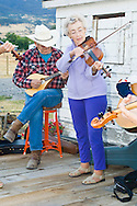 Senior woman fiddler, Alberta Wood, and senior man playing mandolin, Montana Old Time Fiddlers Picnic, Livingston, Montana, <br /> MODEL RELEASED PURPLE LADY ONLY