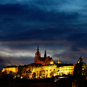 "SHOT 11/22/08 9:49:11 AM -  The Prague Castle at dusk in Prague, Czech Republic. Prague Castle (Czech: Pra?ský hrad) is a castle in Prague where the Czech kings, Holy Roman Emperors and presidents of Czechoslovakia and the Czech Republic have had their offices. The Czech Crown Jewels are kept here. Prague Castle is one of the biggest castles in the world (according to Guinness Book of Records the biggest ancient castle) at about 570 meters in length and an average of about 130 meters wide. Prague is the capital and largest city of the Czech Republic. Its official name is Hlavní m?sto Praha, meaning Prague, the Capital City. Situated on the River Vltava in central Bohemia, Prague has been the political, cultural, and economic centre of the Czech state for over 1100 years. The city proper is home to more than 1.2 million people, while its metropolitan area is estimated to have a population of over 1.9 million. Since 1992, the extensive historic centre of Prague has been included in the UNESCO list of World Heritage Sites. According to Guinness World Records, Prague Castle is the largest ancient castle in the world. Nicknames for Prague have included ""the mother of cities"", ""city of a hundred spires"" and ""the golden city"". Since the fall of the Iron Curtain, Prague has become one of Europe's (and the world's) most popular tourist destinations. It is the sixth most-visited European city after London, Paris, Rome, Madrid and Berlin. Prague suffered considerably less damage during World War II than some other major cities in the region, allowing most of its historic architecture to stay true to form. It contains one of the world's most pristine and varied collections of architecture, from Art Nouveau to Baroque, Renaissance, Cubist, Gothic, Neo-Classical and ultra-modern..(Photo by Marc Piscotty / © 2008)"