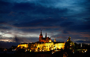 """SHOT 11/22/08 9:49:11 AM -  The Prague Castle at dusk in Prague, Czech Republic. Prague Castle (Czech: Pra?ský hrad) is a castle in Prague where the Czech kings, Holy Roman Emperors and presidents of Czechoslovakia and the Czech Republic have had their offices. The Czech Crown Jewels are kept here. Prague Castle is one of the biggest castles in the world (according to Guinness Book of Records the biggest ancient castle) at about 570 meters in length and an average of about 130 meters wide. Prague is the capital and largest city of the Czech Republic. Its official name is Hlavní m?sto Praha, meaning Prague, the Capital City. Situated on the River Vltava in central Bohemia, Prague has been the political, cultural, and economic centre of the Czech state for over 1100 years. The city proper is home to more than 1.2 million people, while its metropolitan area is estimated to have a population of over 1.9 million. Since 1992, the extensive historic centre of Prague has been included in the UNESCO list of World Heritage Sites. According to Guinness World Records, Prague Castle is the largest ancient castle in the world. Nicknames for Prague have included """"the mother of cities"""", """"city of a hundred spires"""" and """"the golden city"""". Since the fall of the Iron Curtain, Prague has become one of Europe's (and the world's) most popular tourist destinations. It is the sixth most-visited European city after London, Paris, Rome, Madrid and Berlin. Prague suffered considerably less damage during World War II than some other major cities in the region, allowing most of its historic architecture to stay true to form. It contains one of the world's most pristine and varied collections of architecture, from Art Nouveau to Baroque, Renaissance, Cubist, Gothic, Neo-Classical and ultra-modern..(Photo by Marc Piscotty / © 2008)"""