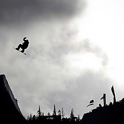 SHOT 12/12/09 1:49:06 PM - Snowboarder Dustin Craven balsts out of the halfpipe during finals at the U.S. Snowboarding Grand Prix at Copper Mountain on Saturday December 12, 2009. Shaun White, Louie Vito and Zachary Black finished on the podium on the men's side while Kelly Clark, Gretchen Bleiler and Soko Yamaoka grabbed the top three spots on the women's side. Craven finished 15th in the event. The competition was the first of three events that will be used to select the U.S. Snowboarding Team for the upcoming Winter Olympics in Vancouver. (Photo by Marc Piscotty / © 2009)
