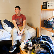 08/29/2012 - Medford/Somerville, Mass. - Incoming student Ben Silver, A16, laughs on his new bed in Miller Hall during move-in on the morning of Wednesday, Aug. 29, 2012. (Kelvin Ma/Tufts University)