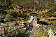 BU00007-00...BHUTAN - Famous chain link bridge, first made by the Iron Bridge Lama, (Thangtong Gyalpo (1385-1464)), over the Paro River. The bridge has been remade using some of the original chain links.