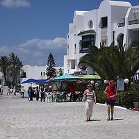 Scenes from Tunisia's resort area, El Kantouai,tourists walking through marina-condo area