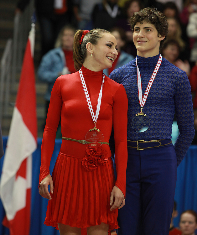 20101031 -- Kingston, Ontario --  Vanessa Crone and Paul Poirier of Canada smile after receiving their gold medal in the ice dance competition at Skate Canada International in Kingston, Ontario, Canada, October 31, 2010. <br /> AFP PHOTO/Geoff Robins