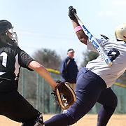 Goldey-Beacom Utility player Asia Ellis (9) makes contact with the ball in the fifth inning of a NCAA Central Atlantic Collegiate Conference game against Post University Saturday, March 30, 2013, at Nancy Churchmann Sawin Athletic Field in Wilmington Delaware.