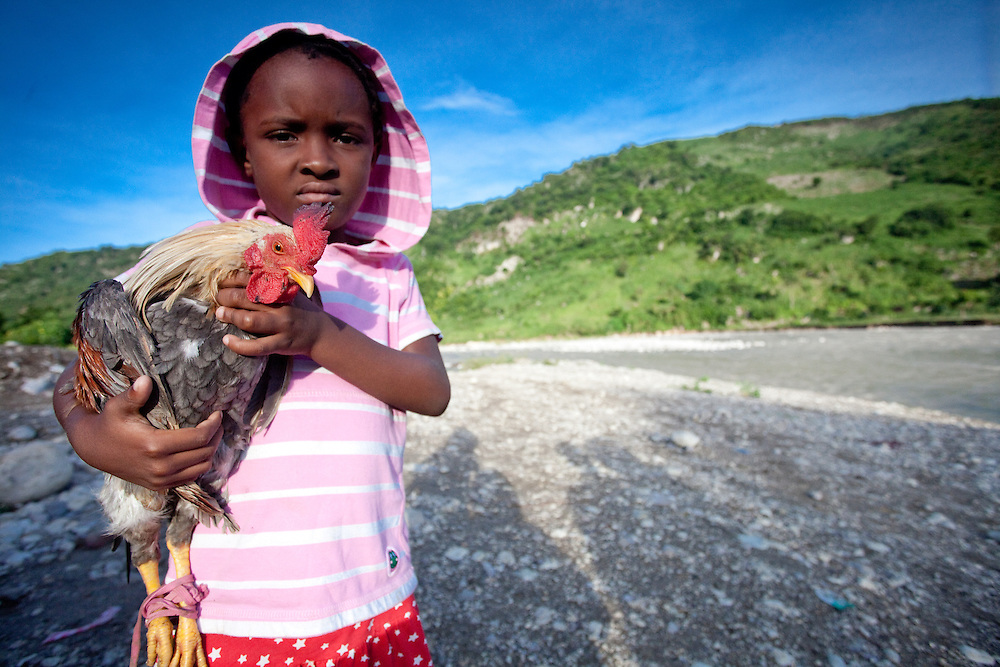 A young girl carries a chicken near Port Salut in the Tiburon Peninsula of Haiti