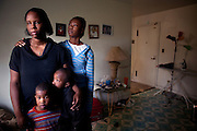 Cherie Michaux, with her daughter Ja'liza Michaux, 12, her nephew Quaheem Moreau, 3, bottom left, and her son Ja'kye Brown, 7, bottom right, in their apartment in Port Chester, NY on October 27, 2012. Cherie Michaux could have benefitted if Westchester County had integrated its housing as it had been ordered to do so.