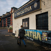 Member of the public walks past the Clutha bar on November 28, 2014 in Glasgow, Scotland. As the first year anniversary of the Clutha Vaults approaches it is still unclear what caused the engine failure that led to a Police Scotland helicopter to crash into the roof of the pub killing ten people.