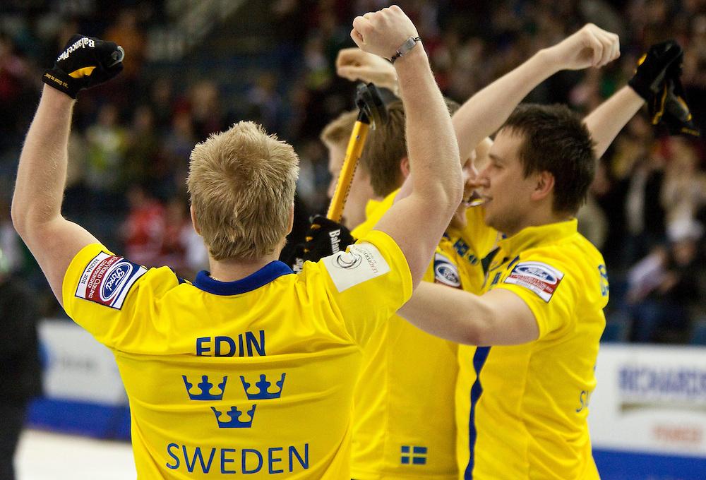 Skip Niklas Edin, left, celebrates Sweden's  7-6 win over Norway in the bronze medal match at the Ford World Men's Curling Championships in Regina, Saskatchewan, April 10, 2011.<br /> AFP PHOTO/Geoff Robins