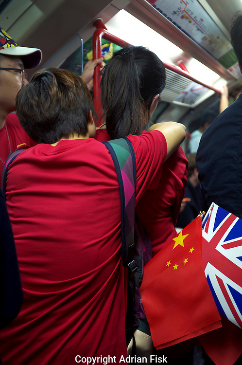 Chinese and British fans ride on the tube together through London