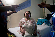 Aurelinda de Marine, diagnosed with asthma and other allergies. Her living room, bathroom and bedroom have holes and mildew.  Her six-year-old great granddaughter also has asthma.  Wald Houses, Lower East Side, NY, 2012.