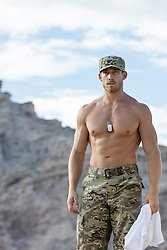 Shirtless muscular Army man without a shirt outdoors