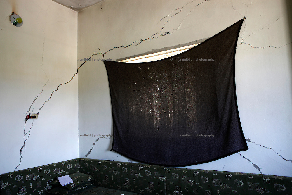 Cracks caused by shelling are seen in a wall of a residential house in Koreen.<br /> _ _ _ <br /> Idlib Interim - Challenging life without central government in the village of Koreen (Idlib Province, Syria)<br /> Koreen joint the syrian uprisung to ouster president Bashar al-Assad at a very early stage in 2011. It has been scene of Army attacks and heavy shelling since 2012. In the course of the fightings the village of a few thousend inhabitants was almost abandoned as barrel bomb campaings commited by the regime pounded Koreen. But since regime forces retreated to few bases remaining in Idlib province people returned home to establish a new and almost unregulated economic, social and community life. The regimes power has no affect and can&acute;t reach them anymore. On the other hand a new government isn&acute;t established yet and not in sight at all. Koreen is free to make its way.