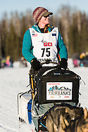 Musher Paige Drobney competing in the 44th Iditarod Trail Sled Dog Race on Long Lake after leaving the restart on Willow Lake in Southcentral Alaska.  Afternoon. Winter.