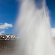 "Strokkur, a geyser in southern Iceland, shoots water 20 meters (70 feet) up into the air. Strokkur is an Icelandic word for ""churning."" The geyser bubbles and churns just before erupting, which it does every five to 10 minutes. It is located next to Geysir, the ""original"" geyer, which no longer erupts regularly."