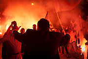 Supporters of L.A.O.S (extreme right wing party) greet the leader Mr Karatzaferis at the Peace and Friendship stadium in Athens, Greece. Image © Angelos Giotopoulos/Falcon Photo Agency