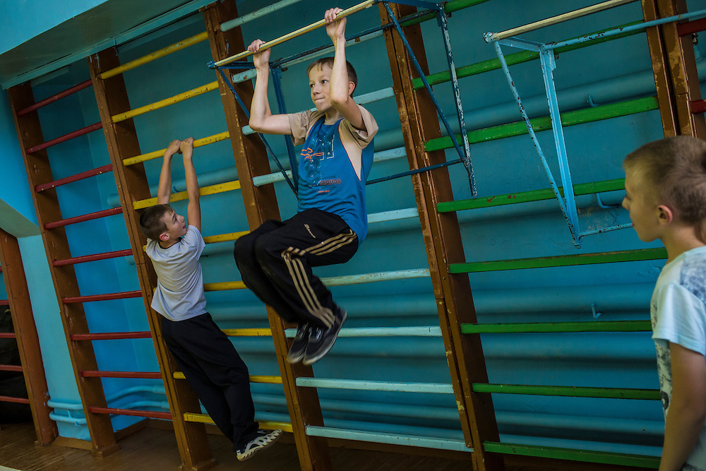 Boys play in the gymnasium after school on Thursday, October 24, 2013 in Baikalsk, Russia.
