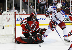 Feb 9, 2009; Newark, NJ, USA; New York Rangers left wing Aaron Voros (34) looks for the rebound after a save by New Jersey Devils goalie Scott Clemmensen (35) during the third period at the Prudential Center. The Devils defeated the Rangers 3-0.