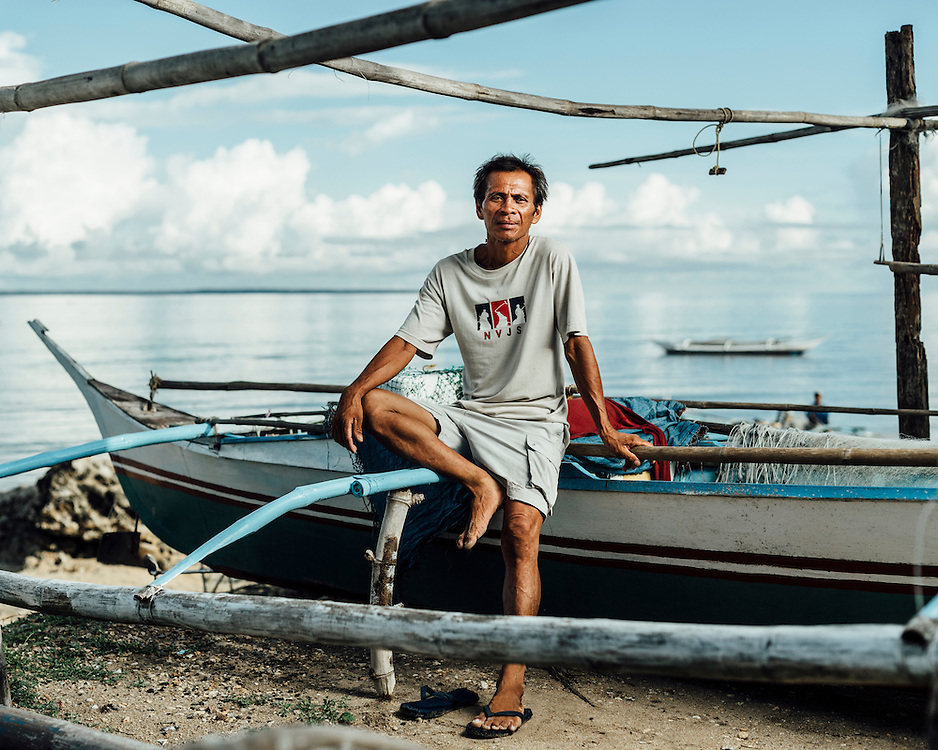 """Elano Chavez, 47, Agujo, Northern Cebu, Philippines. """"I lost my boat."""" 