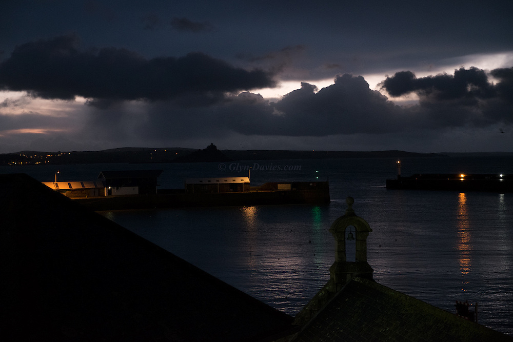 First light of dawn over St Michael's Mount, Mount's Bay, Penzance last week. Delicate burns of daylight gradually fanned into a gentle glow over the calm waters of the old town's harbour