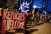 Frankfurt am Main   21 Apr 2015<br /> <br /> Am Dienstag (21.04.2015) hielt die rassistische und islamfeindliche Gruppe PEGIDA (Patriotische Europ&auml;er gegen die Islamisierung des Abendlandes) an der Hauotwache neben der Katharinenkirche in Frankfurt am Main eine Mahnwache unter dem Motto &quot;Wir sind wieder da&quot; ab. Die Kundgebung war wie immer mit Hamburger Gittern abgesperrt und von starken Polizeikr&auml;ften bewacht. Etwa 1000 Menschen nahmen an den Gegenprotesten teil.<br /> Hier: Gegendemonstranten mit einem Transparent mit der Aufschrift &quot;Refugees Welcome&quot; bei einer Spontandemo nach Ende der Pegida-Kundgebung am Euro-Zeichen am Willy-Brandt-Platz, bei dieser Demo ging es um Flucht und Fl&uuml;chtlinge.<br /> <br /> &copy;peter-juelich.com<br /> <br /> [Foto Honorarpflichtig   No Model Release   No Property Release]