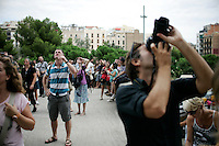 20110903 - Barcelona, Spain - Tourists snap photos of architecture in Barcelona, Spain..(Matthew Healey)