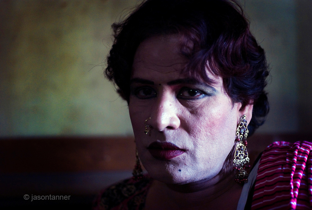 Sheza Shahnawaz, a 42 year old Hijra is the Guru (leader) of the Hijra community in the deprived suburb of Agra Taj in Karachi. <br /> <br /> The word Hijra is an Urdu word meaning eunuch or hermaphrodite. However, most Hijras in Pakistan are gay men who leave home to join the Hijra community as young boys where there is more acceptance. Most identify themselves as more feminine then masculine and dress and act accordingly.<br /> <br /> Although tolerated in a country where homosexuality is against the law, Hijras are largely ostracised from society. They are often denied work opportunities, rejected by most families, lack formal education and live in poorer areas of the city.<br /> <br /> They share similarities with the more famous Hijra communities in the Indian subcontinent and Bangladesh. In a continent where great emphasis is placed on one&rsquo;s ability to have children, those who are unfortunate not to be able to conceive children are not considered a true man or woman. Life for many Hijras in Pakistan consists of begging for alms (Zakat) in the more prosperous areas of the city as well as slums in addition to receiving alms when bestowing blessings on male babies and at weddings..<br /> <br /> Most Hijras dress as women, and engage in activities such as dancing and entertaining in public &ndash; activities that would be considered inappropriate for women of the subcontinent. Some members of the community engage in prostitution.