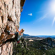 Meredith Fossitt on Mogwai, 5.11b, at Mural Wall at Shelf Road in Colorado. Photography by Kris Ugarriza