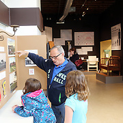 "Terry Williams, who grew up in Salem, shows an exhibit to his granddaughters Madilyn and Natalie. The Oregon State Hospital in Salem has been home to psychiatric patients for more than a century. The movie ""One Flew Over the Cuckoo's Nest"" was filmed there, and the new Oregon State Hospital Museum of Mental Health honors the experiences of the patients who have lived there over the decades."