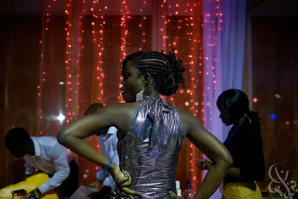 A Nigerian woman waits for a drink  in a concession line at the 3rd annual THISDAY music and fashion festival July 11, 2008  in Abuja, Nigeria. The annual festival is designed to raise awareness of African issues while promoting positive images of Africa using music, fashion and culture in a series of concerts and events in Nigeria, the United States and the United Kingdom. ..