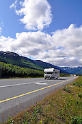 An RV passes through Turnagain Pass along the Seward Highway.