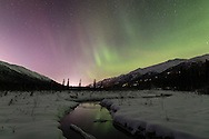 Aurora over Eagle River Valley in Southcentral Alaska. Winter. Evening.
