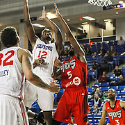 Delaware 87ers Forward SAM THOMPSON (12) drives towards the basket as Raptors 905 Guard SCOTT SUGGS defends (5) in the second half of a NBA D-league regular season basketball game between the Delaware 87ers and the Raptors 905 Friday, Jan. 15, 2016. at The Bob Carpenter Sports Convocation Center in Newark, DEL.