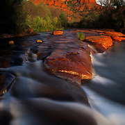 Cathedral Rocks and a rushing creek in Red Rock Crossing State Park, Sedona, AZ.