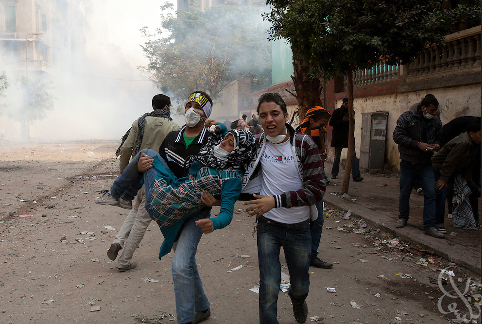 A wounded Egyptian protestor is carried off the battlefield during clashes with Egyptian security forces November 21, 2011 near Tahrir square  in central Cairo, Egypt. Thousands of protestors demanding the Egyptian military cede power to a civilian authority clashed with Egyptian security forces for a third straight day in Cairo, with hundreds injured and at least 24 protestors killed.  (Photo by Scott Nelson)