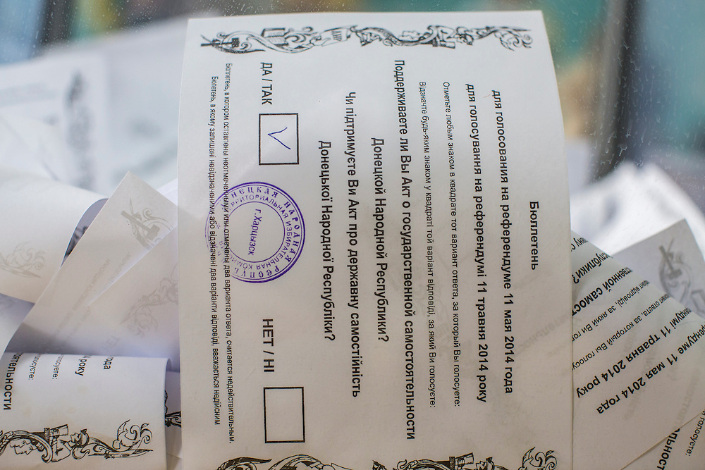 HARTSIZK, UKRAINE - MAY 11: A ballot marked in favor of greater autonomy sits in a ballot box on May 11, 2014 in Hartsizk, Ukraine. A referendum on greater autonomy is being held after pro-Russian activists took over at least ten cities in the eastern part of the country in a bid for less control from the central government from Kiev. (Photo by Brendan Hoffman/Getty Images) *** Local Caption ***