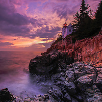 Bass Harbor Head Light is a picturesque lighthouse located on Mount Desert Island within Maine Acadia National Park on the southeast corner of MDI. The lighthouse towers over the swirling Atlantic Ocean and seacoast, marking the entrance to Bass Harbor and Blue Hill Bay. It is one of the most iconic scenery of Acadia NP as Bass Harbor Light is dramatically located on the edge of rugged cliffs.<br />