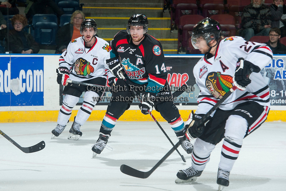 KELOWNA, CANADA - NOVEMBER 22: Rourke Chartier #14 of Kelowna Rockets looks for the pass in front of Nicolas Petan #19 of Portland Winterhawks on November 22, 2014 at Prospera Place in Kelowna, British Columbia, Canada.  (Photo by Marissa Baecker/Shoot the Breeze)  *** Local Caption *** Nicolas Petan; Rourke Chartier;