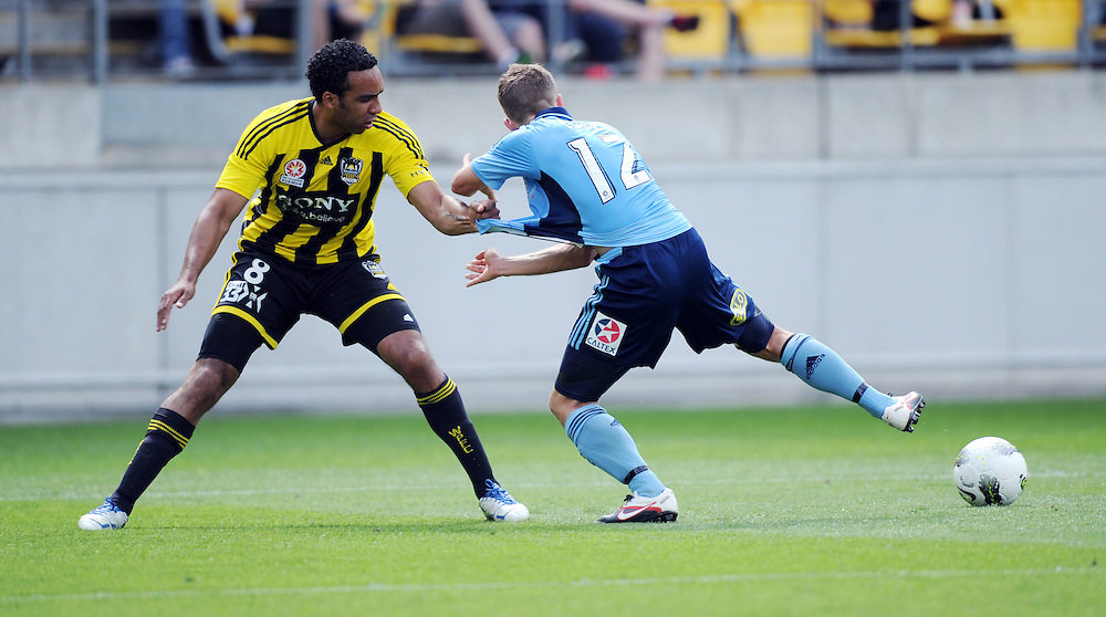 Phoenix's Paul Ifill, left, holds back Sydney FC's Shannon Cole in the A-League football match at Westpac Stadium, Wellington, New Zealand, Wednesday, January 04, 2012. Credit:SNPA / Ross Setford
