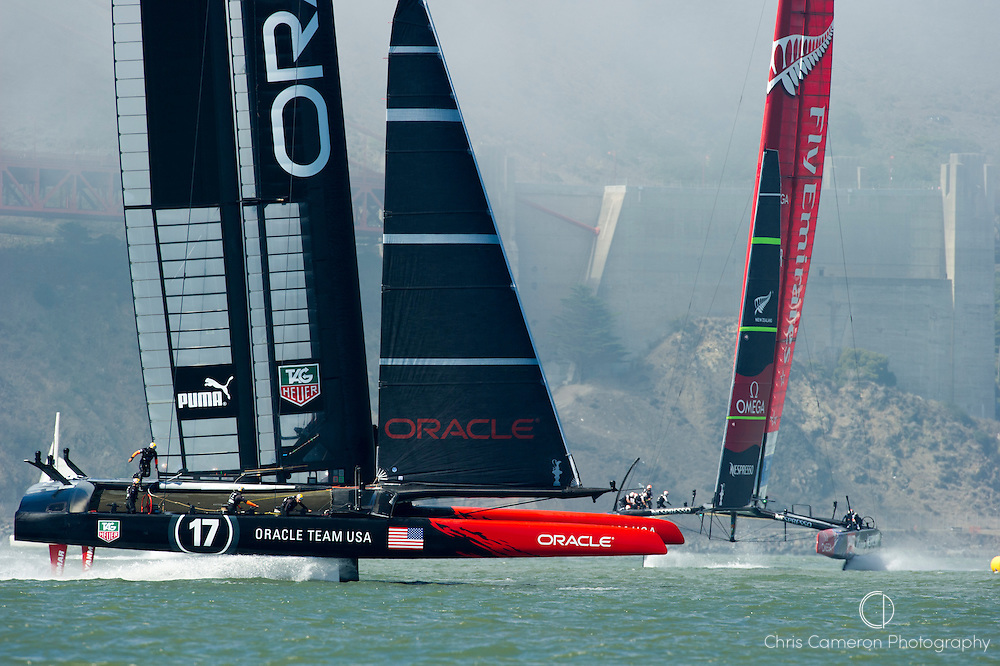 Oracle Team USA and Emirates Team New Zealand enter the start box for race 14 on day 12 of America's Cup 34. 22/9/2013
