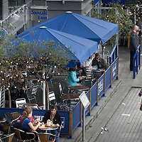 UK. London. Bankside on London's Southbank. People enjoying the sunshine.
