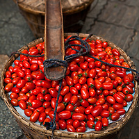 Tomatoes for sale from a mobile vendor on streets of Chengdu