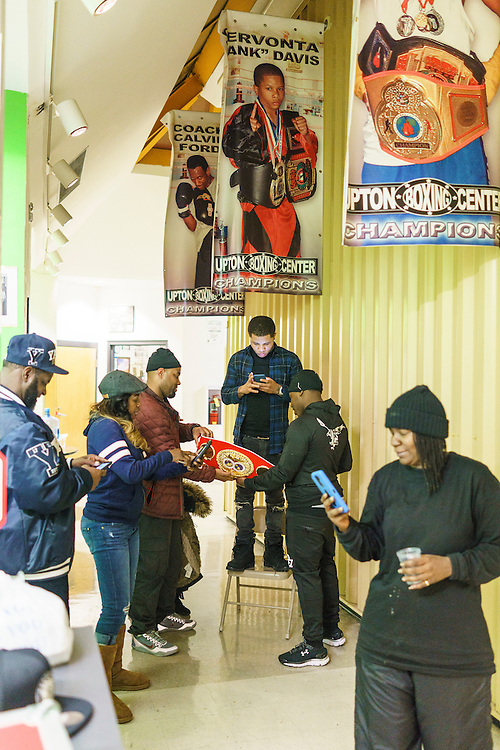 Baltimore, Maryland - January 26, 2017: IBF Junior Lightweight Champion Gervonta Davis checks his phone in between photos made with his championship belt under his &quot;Champions&quot; banner at the Upton Boxing Club in Baltimore Thursday January 26, 2017.<br /> <br /> <br /> CREDIT: Matt Roth for The New York Times<br /> Assignment ID: