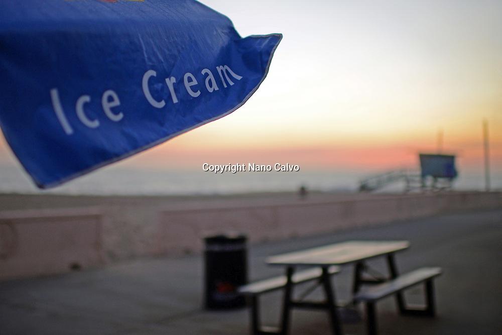 Ice Cream sign in umbrella and table in Malibu beach, California.