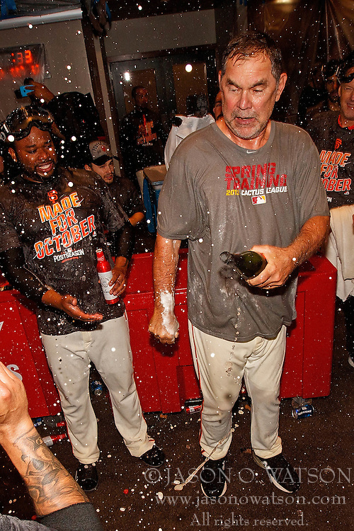 SAN FRANCISCO, CA - OCTOBER 02: Bruce Bochy #15 of the San Francisco Giants celebrates with Johnny Cueto #47 in the clubhouse after the game against the Los Angeles Dodgers at AT&T Park on October 2, 2016 in San Francisco, California. The San Francisco Giants defeated the Los Angeles Dodgers 7-1 to advance to the National League Wild Card game. (Photo by Jason O. Watson/Getty Images) *** Local Caption *** Bruce Bochy; Johnny Cueto