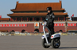 A Chinese policewoman patrol Tiananmen Square on a self balancing police vehicle before the opening ceremony of the 4th session of the 11th National Committee of the Chinese People's Political Consultative Conference (CPPCC) at the Great Hall of the People in Beijing, China 03 March 2011. The CPPCC is the top advisory body of the Chinese political system and the session precedes the 8 days of annual plenary meetings of the 11th National People's Congress (NPC) which is due to commence 05 March 2011. The two meetings are the first public declaration of the goals of the next five year plan and lay the groundwork for the economic and political direction of the country