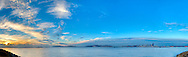 Panoramic photograph of the Puget Sound with Seattle, Washington in the distance.  Print Size (in inches): 15x4.5; 24x7; 36x11; 48x14.5; 60x18; 72x22
