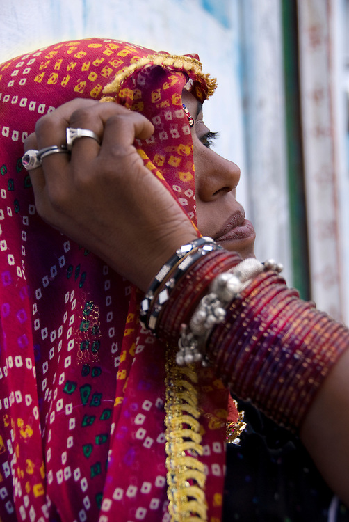 Many women in Rajasthan wear an 'odhni', a  long piece of cloth (3 meters by 2 meters). The odhni usually goes together with the 'ghagra' 'choli' or 'lehengas', but is also worn over a saree on special occasions. One end of it is tucked into the skirt or saree at the waist. It is draped gracefully across like a saree and partly covers the head in a short veil.